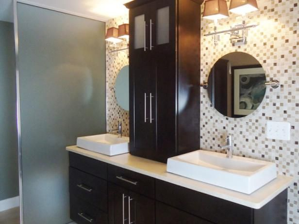 Soaking Tub Surrounded by Green Mosaic Tile