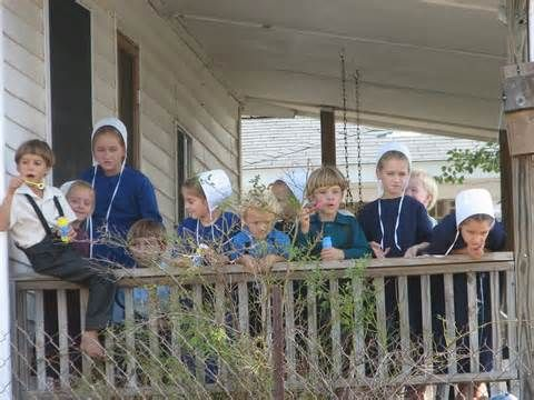 Amish children watching the world go by