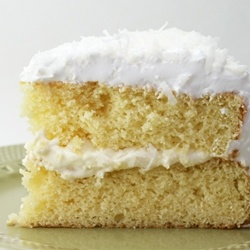 Coconut Layer Cake with lemon curd filling and seven-minute frosting.