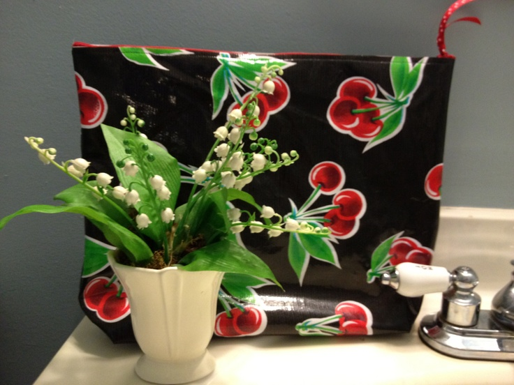 Large waterproof cosmetic bag or wet bag of oilcloth in red cherries