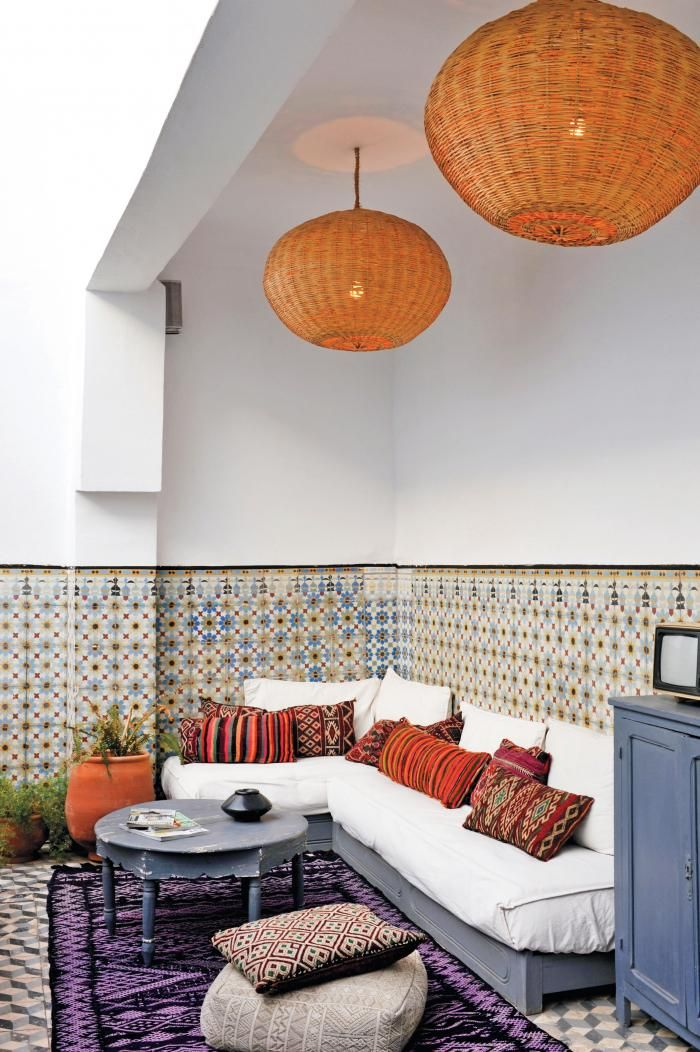 A Moroccan banquette in a riad. Typically, banquettes are made from wood bases with a mattress on top and plenty of cushions.