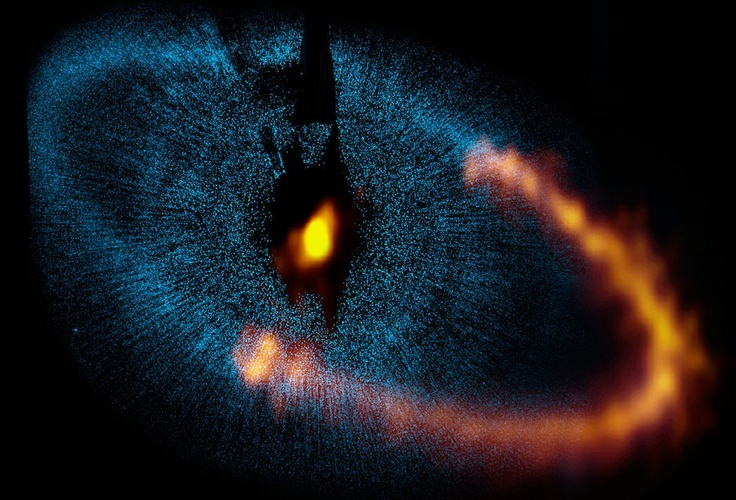 This view shows a new picture of the dust ring around the bright star Fomalhaut from the Atacama Large Millimeter/submillimeter Array (ALMA). The underlying blue picture shows an earlier picture obtained by the NASA/ESA Hubble Space Telescope. The new ALMA image has given astronomers a major breakthrough in understanding a nearby planetary system and provided valuable clues about how such systems form and evolve. Note that ALMA has so far only observed a part of the ring.