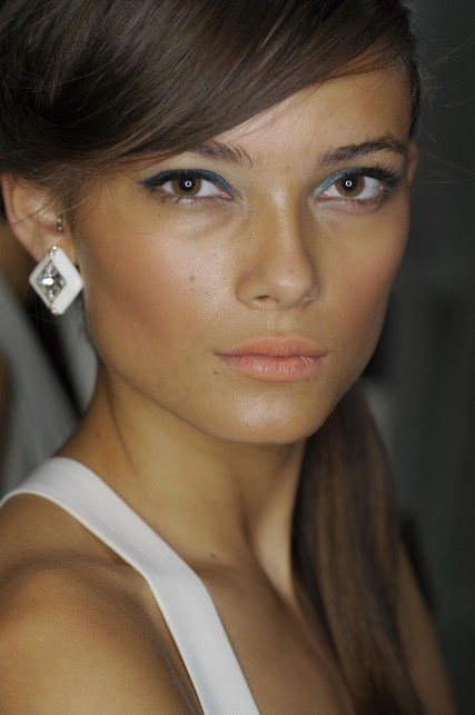 '60s-chic: A swipe of teal shadow and a side ponytail from the Jenny Packham spring '13 runway show