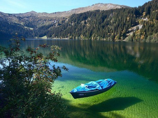 boat & the clear clear water of Arnensee (French: Lac d'Arnon)...a lake in Canton of Berne, Switzerland. Wow...beautiful!