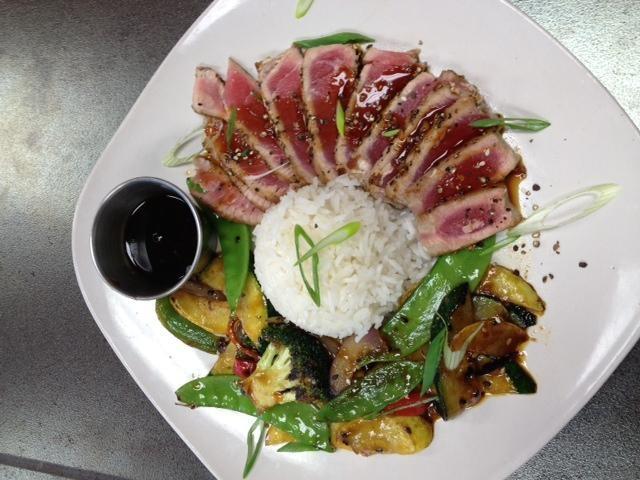 ... encrusted ahi tuna with sticky rice and sesame teriyaki vegetables