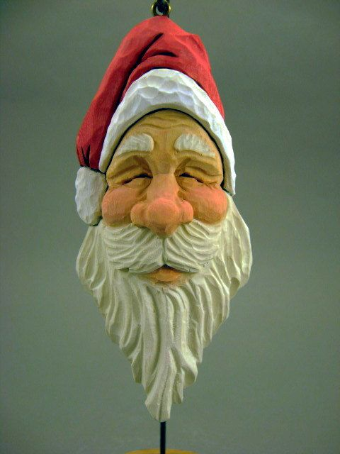 Hand carved wood santa ornament