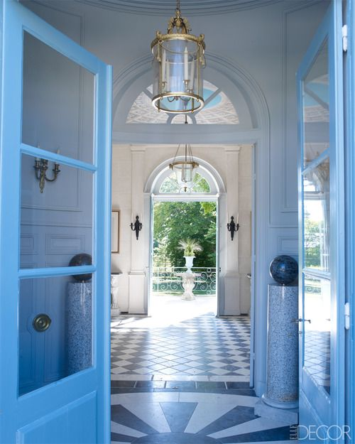 Blue doors, inlaid black and white marble floors, through to another set of double doors with fabulous demilune, leading out to a garden.