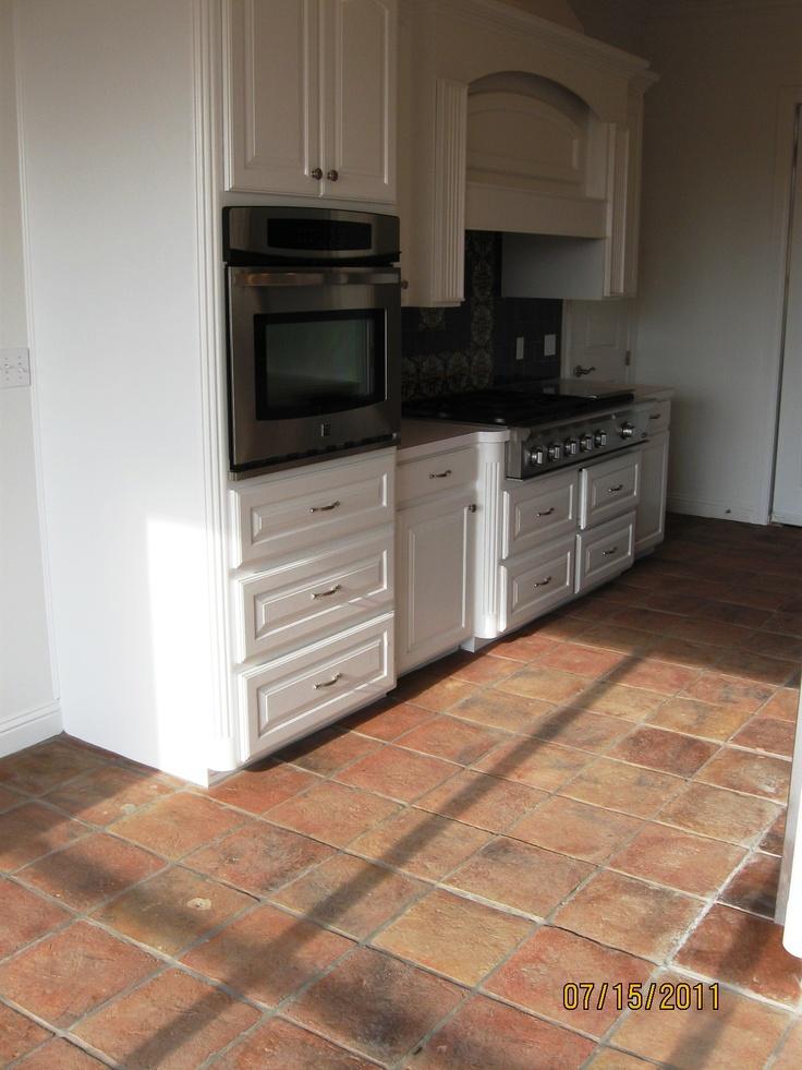 white kitchen terracotta floor kitchen ideas