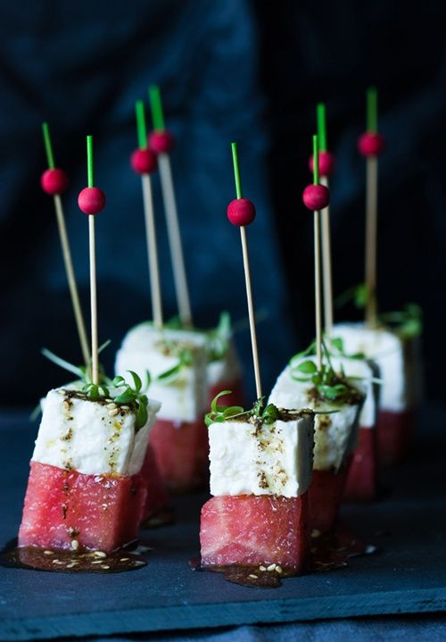 Watermelon & Baya Cheese Skewers topped with thyme & mint and drizzle...