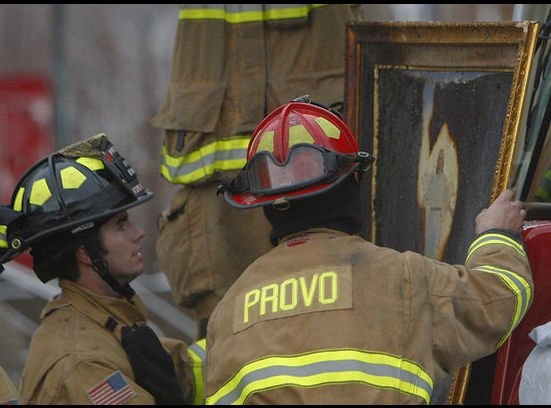Provo Tabernacle Fire Miracle: Provo Firefighters look at a painting of Christ that was burned in the fire. The fire burned the entire image except the image of Christ near the center. That's Incredible.