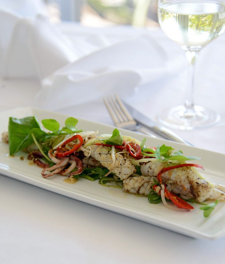 ... fried squid with cucumber, bean sprout, coriander and watercress salad