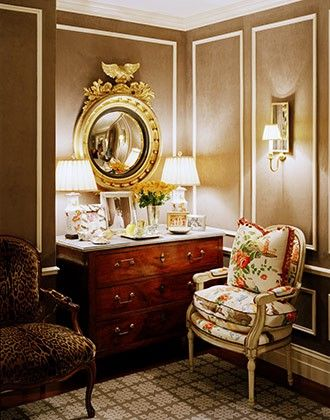 Mocha walls, Federal convex mirror, mirrored sconce, antique dresser, chintz and animal print upholstery - former apartment of Tinsley and Topper Mortimer