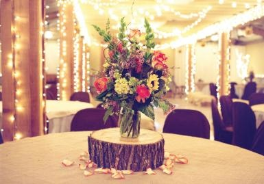 Rustic ranch wedding with stump centerpiece