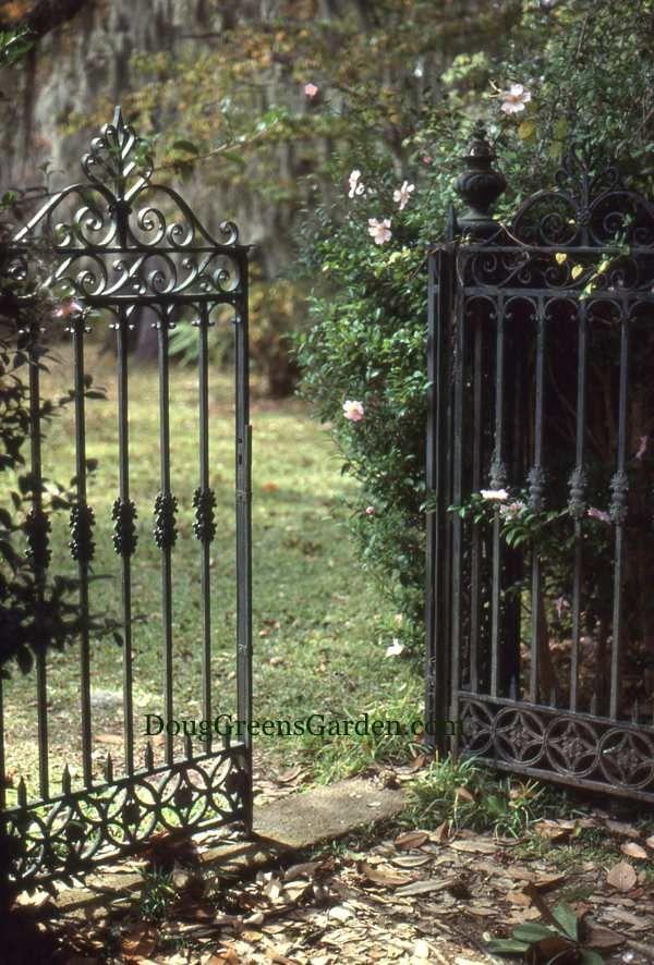 Formal iron gates for a formal garden stairs rails for Garden door designs