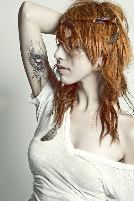 bird nest tattoo. feathers crown. AND GIRL :D