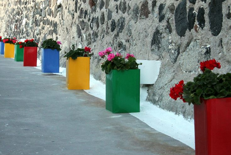 "These pretty flower pots were photographed in Santorini, Greece. But use colorful paper bags as the ""flower pots,"" and this would be such a pretty idea for party decorations or to line an outdoor wedding aisle or to grace picnic or party tables. Place recycled glass jars or wood blocks inside bags or fill bags with sand to raise smaller plants so they just peek out of the bags. Alternate with paper bag luminaries for day-to-nighttime entertaining."