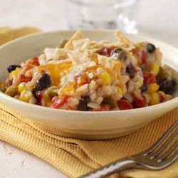 Rice, black beans, zesty tomatoes and corn combined with cheddar cheese soup in one bowl and baked -- perfect for a vegetarian weeknight meal