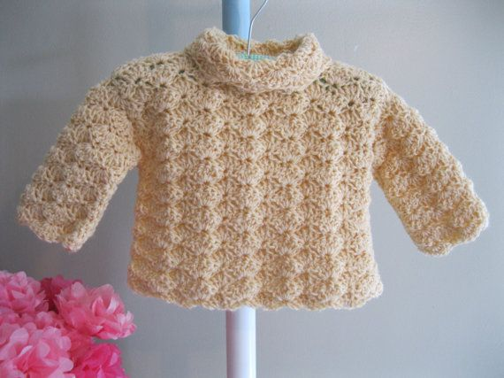 Crocheted baby sweater......yellow shell stitch pullover