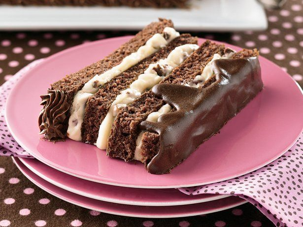 An eye catching four layer cake features toffee white chocolate