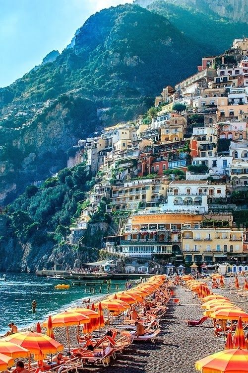 Positano, Italy. Julie and I stayed in this gorgeous little town by the Med. Julie found us the most delightful hotel. I swam one day in the Med, that was one of the highlights for me.  Our room was 350 steps up from the beach; another 350 to top of the village.