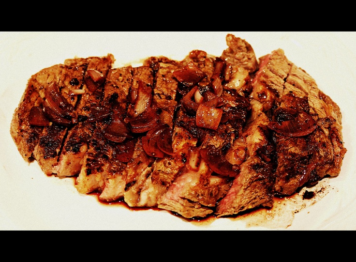 Steak with a red wine sauce, sauteed mushrooms cooked medium well.
