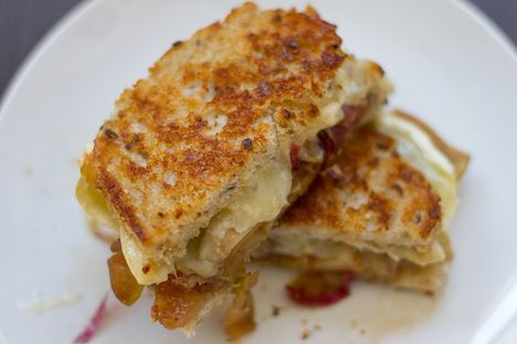 Grilled cheese sandwich made with brie, apples, red onion confit