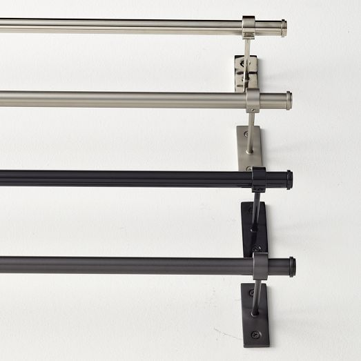 ... support brackets mounted at the far ends & in the center of the rod to