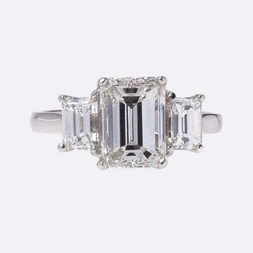 Emerald cut three stone engagement ring Pretty rings