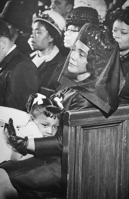 Coretta Scott King at the funeral for Martin Luther King, Jr.  -  On May 5, 1969,  Photographer,  Moneta J. Sleet Jr. won the 1969 Pulitzer Prize for Photography for this image of Coretta Scott King at her husband's funeral. Wearing a black veil and looking stoic, Mrs.  King holds her daughter who is slumped over her mother's lap.  It's said to be one of the most graceful images of the Civil Rights Movement.