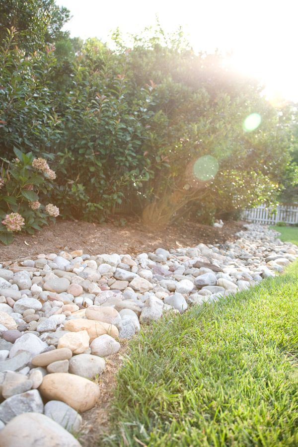River rock border garden pinterest for River rock landscaping