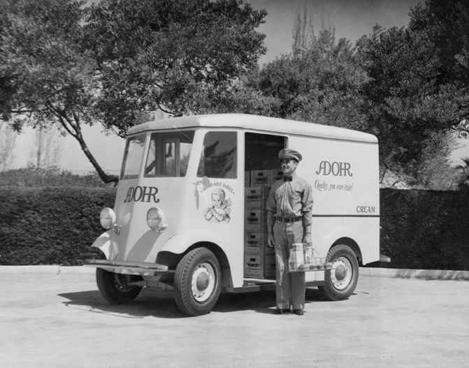 Milkman with delivery truck for Adohr Farms in Reseda, circa 1935-1937. The Adohr Farms milk dairy was located in Tarzana, California at Ventura Boulevard and Lindley Avenue. The dairy was established by Merritt Adamson 1916, and named for his wife, Rhoda (spelled backwards). Adohr Farms Collection. San Fernando Valley History Digital Library.