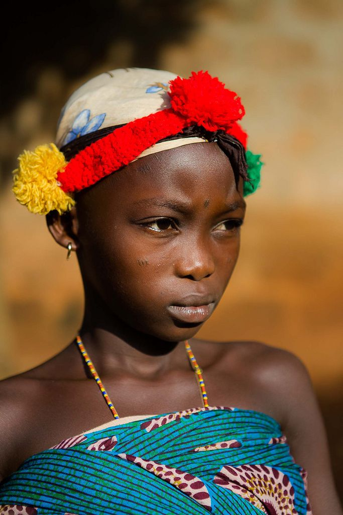 portrait of a little girl during an initiation ceremony voodoo in possotome, benin