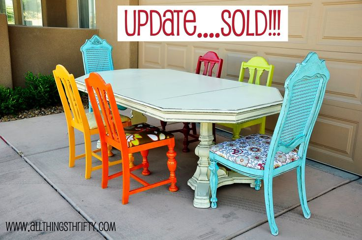 inspiring dining room table with colorful chairs sold
