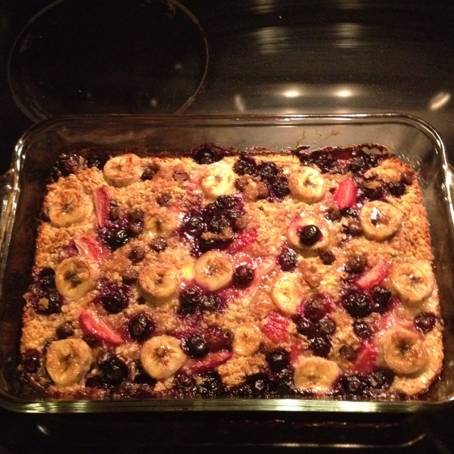 Baked oatmeal with strawberries, blueberries, banana and choc chips!