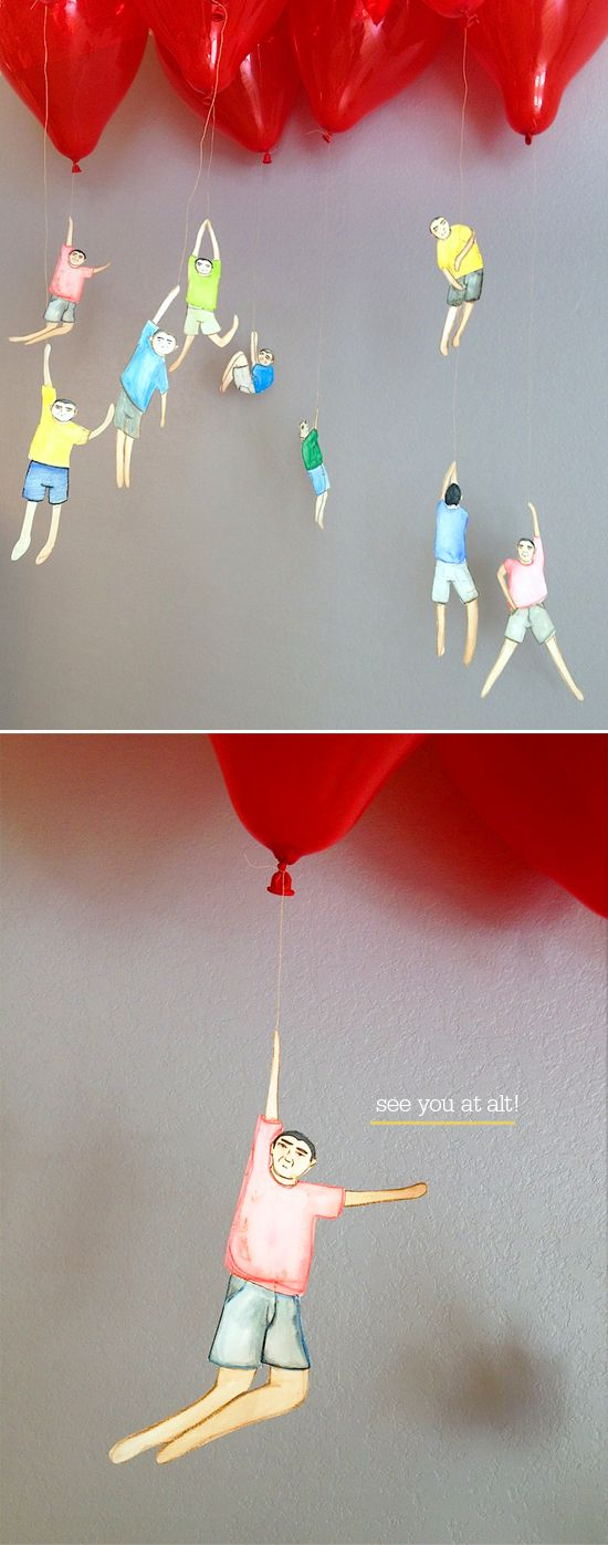 little people hanging from balloons.