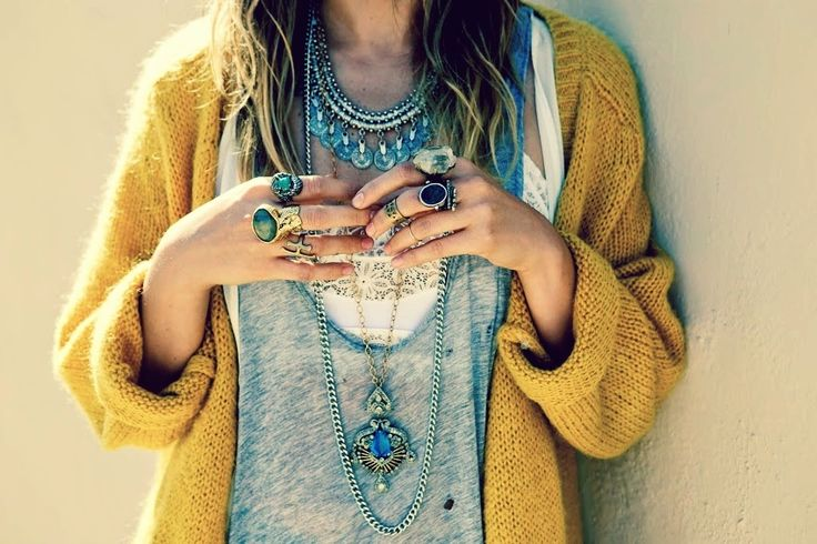 Love the slouchy knit, layered vests, chunky jewels!