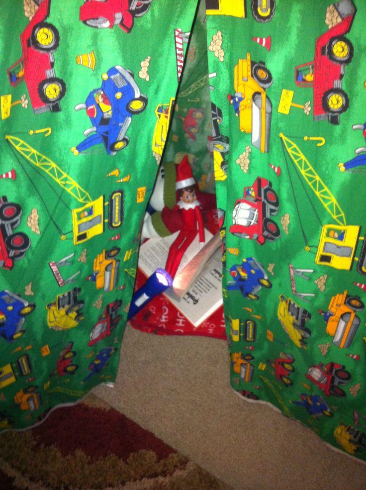 "Elf on the shelf - under play tent reading ""Goosebumps"" by flashlight"