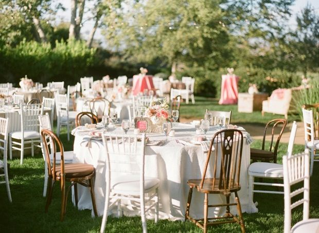Mismatched round tables and chairs outside wedding for Table and chair decorations for weddings