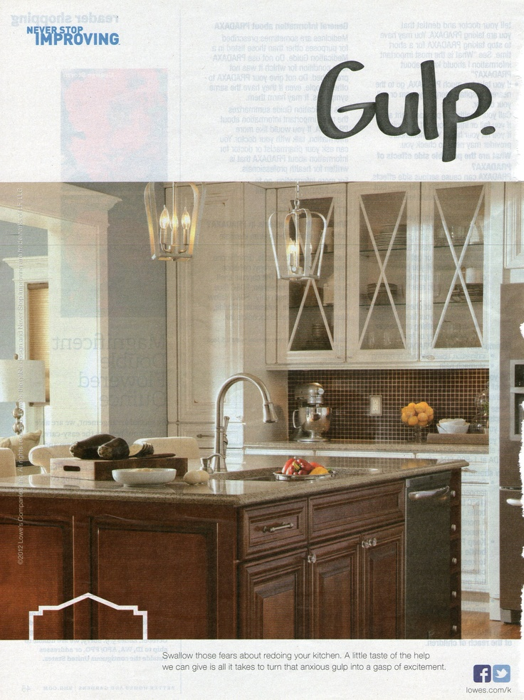 white upper cabinets and dark wood lower cabinets