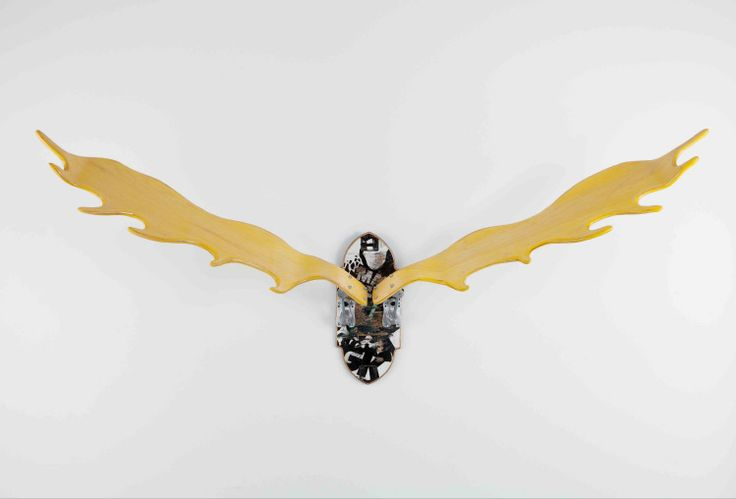 Joshua Van Dyke's work is currently on view at Provide. He uses skateboard decks to create antler and wildlife trophies.