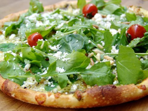 ... Summer Pizza-basil pesto, pine nuts, mozzarella, tomatoes and arugula