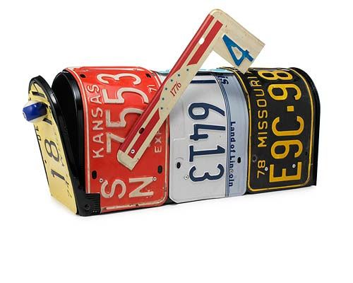 Fabulous and funky mailbox made out of license plates.