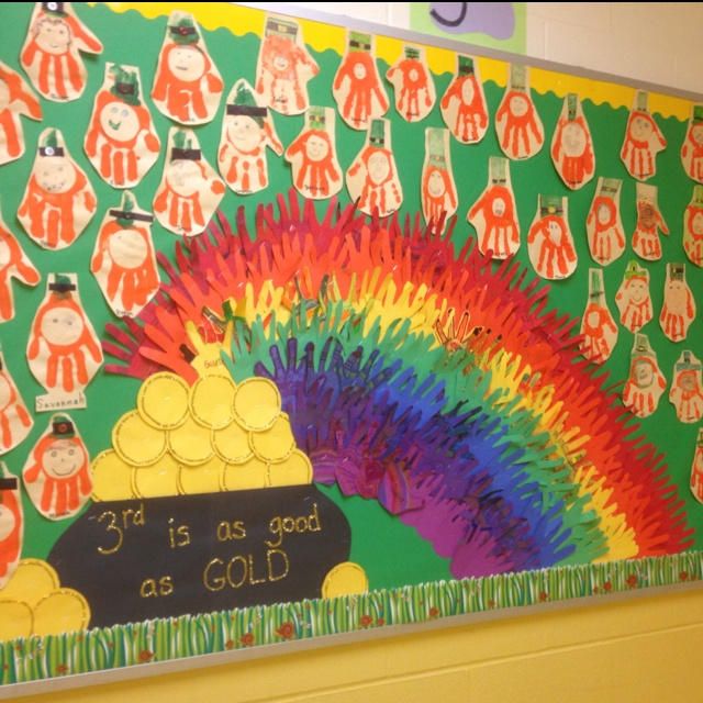 """ ____ Grade is as Good as GOLD!"" is a fun title for a March bulletin board display.  I love the colorful rainbow that was made out of hands.  The leprechauns were made using students' hand prints."