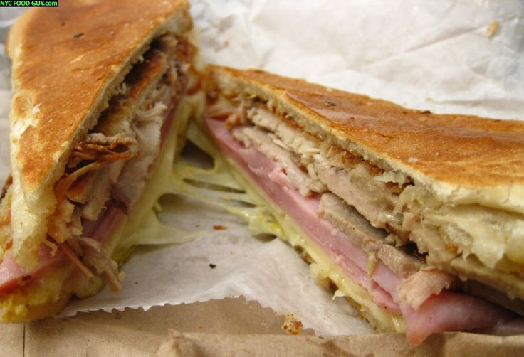 Cuban Sandwich, or Cubano. A pressed sandwich on a buttered roll with ...