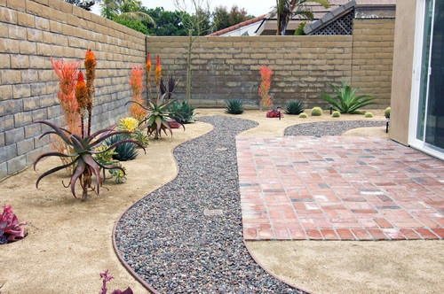 Xeriscaped Backyard Design : Xeriscaped backyard  river rock stream looks lovely!