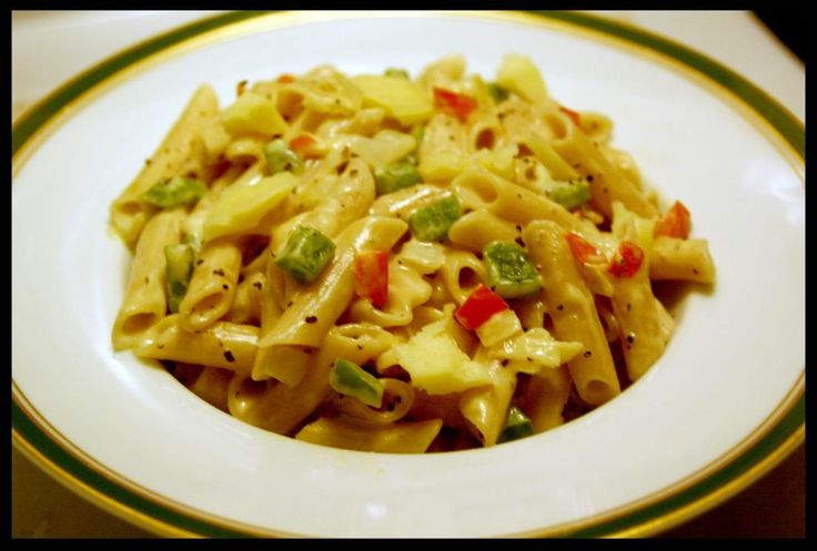 Gluten free penne pasta with green bell pepper, red jalapeno pepper ...