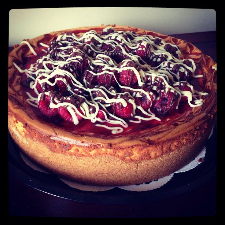 swirl cheesecake, with raspberry glaze, fresh raspberries, and dark ...