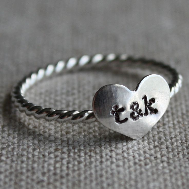 true love ring - sterling silver and stamped with your initials. $27.50, via Etsy. I want this.