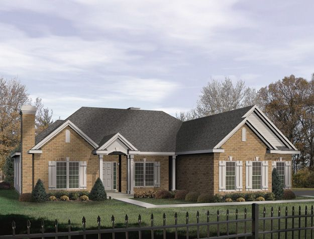 The Front Gables And A Covered Porch Of This Traditional
