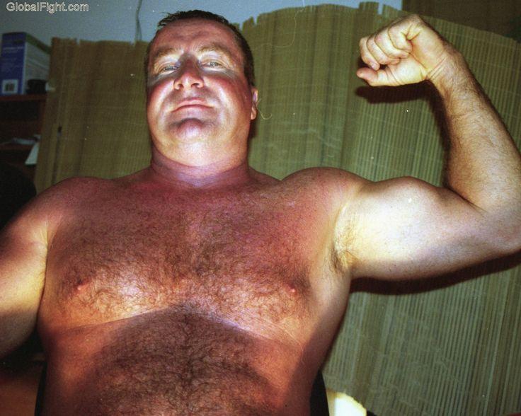 dads flexing big peaked biceps